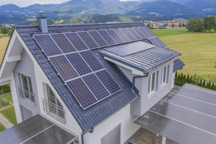 aerial-view-of-a-private-house-with-solar-panels-on-the-roof